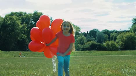 Girl-With-Red-Balloons-Walking-In-The-Hill-And-Smiling