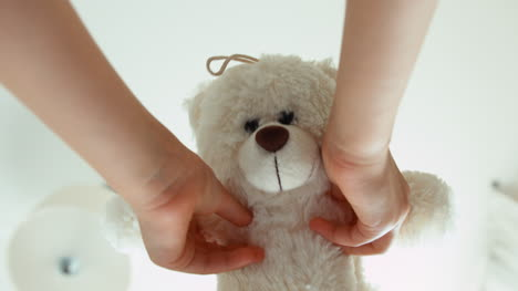 Hands-Of-The-Child-Playing-With-Teddy-Bear
