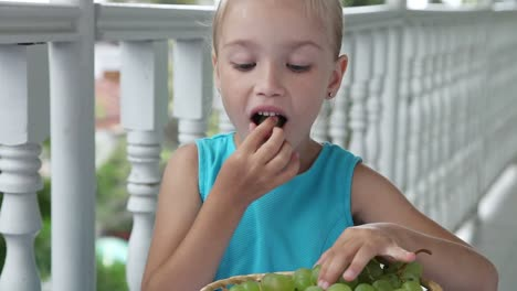 Happy-Child-Playing-In-The-Kids-Count-And-Eating-Grapes-Child-Shows-Ok-