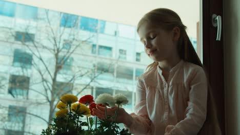 Happy-Girl-Admiring-Flowers