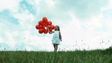 Happy-Girl-With-Red-Balloons-Walking-At-Camera
