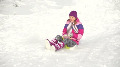 Happy-Woman-Riding-On-A-Toboggan-Down-The-Hills