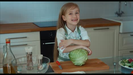 Laughing-Girl-Chef-In-The-Kitchen-Looking-At-Camera-Zooming