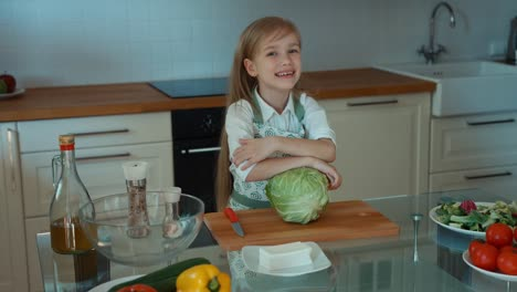 Laughing-Girl-Chef-In-The-Kitchen-Looking-At-Camera
