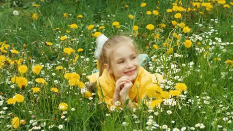 Laughing-Girl-Lying-In-The-Grass-And-Looking-At-Camera