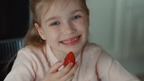 Laughing-Girl-With-A-Big-Red-Strawberry