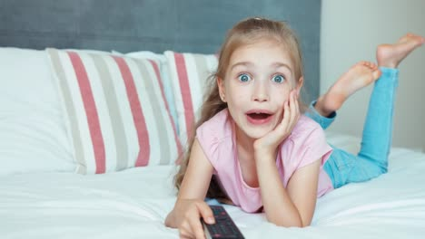 Laughing-Girl-Watching-Tv-Child-Lying-On-The-Bed-Child-Shocked-Tv