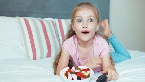 Laughing-Girl-Watching-Tv-Child-Shocked-Tv