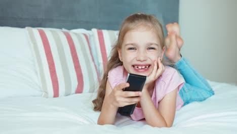 Laughing-Girl-Watching-Tv