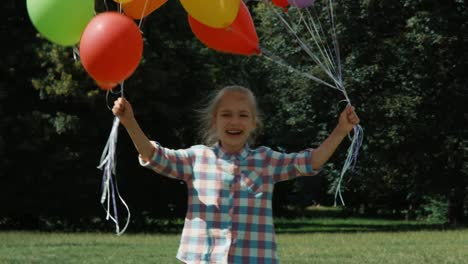 Laughing-Girl-With-Balloons-Whirling-In-The-Park