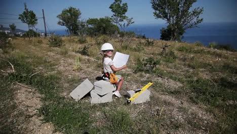 Little-girl-in-a-construction-helmet-wears-sunglasses-2