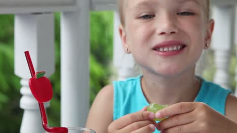 Little-Girl-Eating-Big-Sweet-Grapes-Closeup-Of-A-Child-With-Food