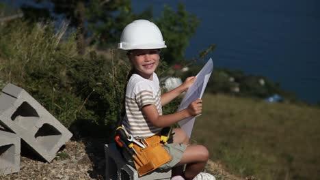 Little-Girl-Is-Builder-She-Is-In-The-Construction-Helmet
