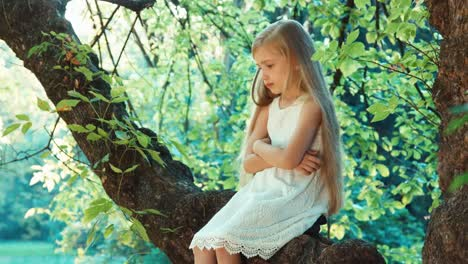 Lonely-Girl-Child-Sitting-On-A-Tree-And-Crying