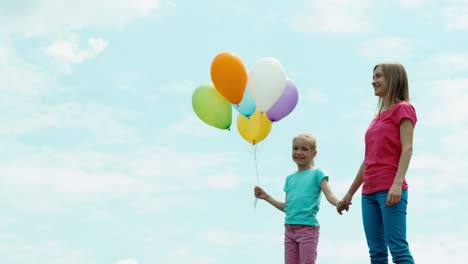Mother-And-Daughter-With-Balloons-Looking-At-Camera-Child-Holding-Balloons-01