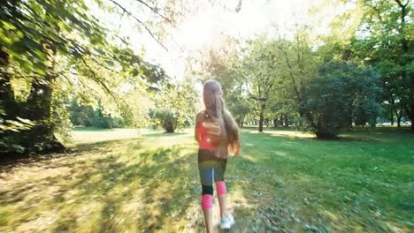Portrait-Athlete-Girl-Niño-Running-Away-From-Camera-In-The-Sunlight-In-The-Park