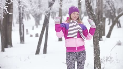 Portrait-Cute-Young-Woman-Playing-With-Snow-She-Is-Smiling-And-Spinning