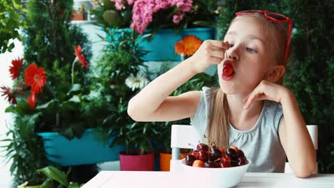 Portrait-Girl-Eating-Cherry-And-Looking-Out-Distance