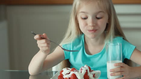 Portrait-Girl-Eating-Strawberries-With-Cream-And-Drinking-Milk-And-Smiling