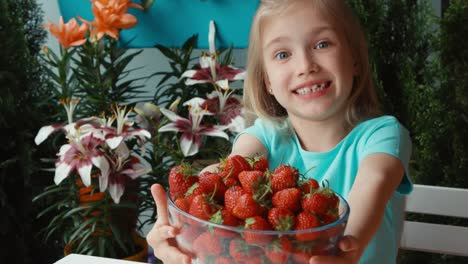 Portrait-Girl-Holding-Big-Plate-Of-Strawberries-And-Smiling-At-Camera