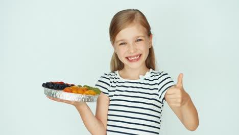 Portrait-Girl-Holding-Cake-With-Fruit-On-The-White-Background-Thumb-Up-Ok