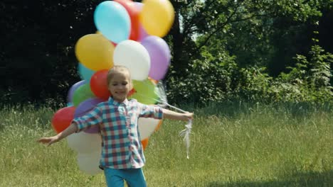 Portrait-Girl-Running-And-Spinning-With-Balloons-In-The-Meadow-At-Camera