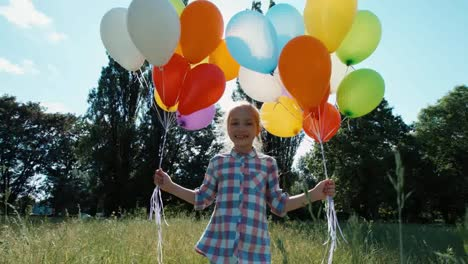 Portrait-Girl-Walking-At-Camera-With-Balloons-In-The-Park-And-Spinning-At-Camera