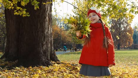 Portrait-Happy-Child-Girl-Holding-A-Bouquet-Of-Autumn-Leaves