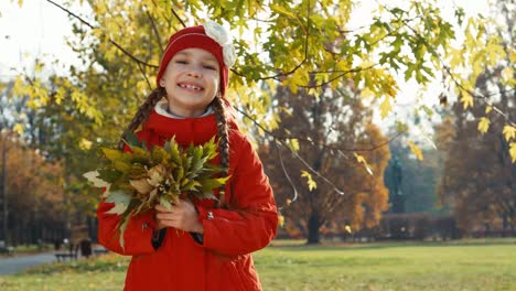 Portrait-Happy-Child-Girl-Holding-And-Hugging-A-Bouquet-Of-Autumn-Leaves-In-T