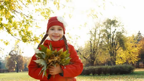 Portrait-Happy-Girl-7-Years-Old-Holding-And-Hugging-A-Bouquet-Of-Autumn-Leave