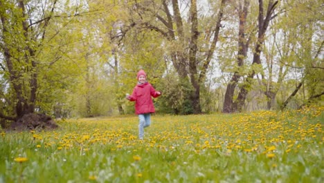 7-8-Years-Girl-Running-And-Spinning-In-The-Park-In-The-Spring