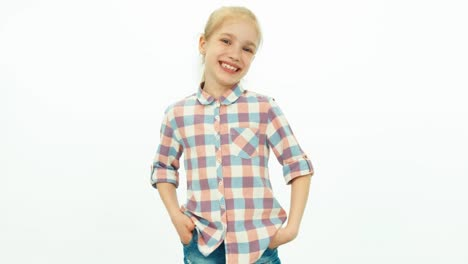 7-8-Years-Old-Girl-In-The-Jeans-And-A-Shirt-Standing-On-The-White-Background