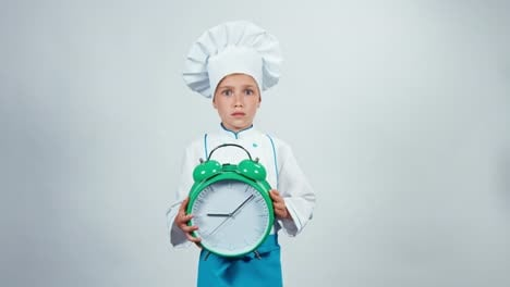 Alarm-Clock-Ringing-Little-Chef-Cook-Holds-Big-Alarm-Clock-Standing-On-White
