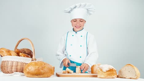 Baker-Cutting-And-Eating-Slice-Of-Bread-Isolated-On-White-Background