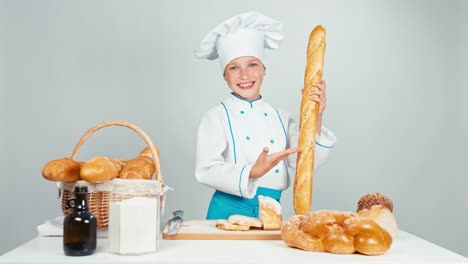 Baker-Girl-7-8-Years-Child-Gives-You-Bread-Baguettes-And-Smiling-At-Camera