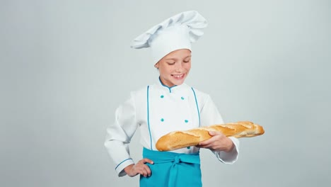 Baker-Girl-7-8-Years-Child-Holds-Bread-Baguette-And-Gives-You-It-At-Camera