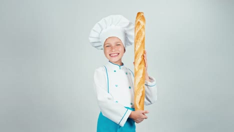 Baker-Girl-7-8-Years-Child-Holds-Bread-Baguette-And-Smiling-At-Camera