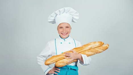 Baker-Girl-7-8-Years-Child-Holds-Bread-Baguettes-And-Smiling-At-Camera-On-White