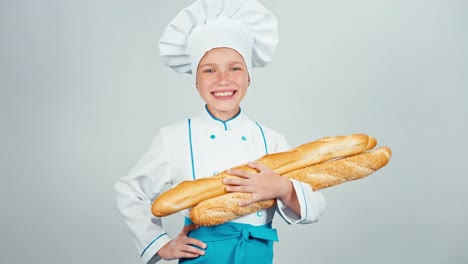 Baker-Girl-7-8-Years-Child-Holds-Bread-Baguettes-And-Smiling-At-Camera