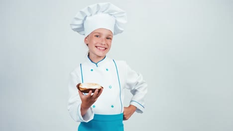 Baker-Holding-Cake-With-Cream-And-Gives-You-It-Chef-7-8-Years-Smiling-At-Camera