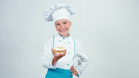 Baker-Holding-Little-Cake-With-Cream-Chef-7-8-Years-Smiling-At-Camera-Isolated