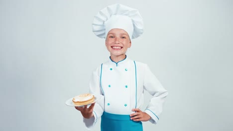 Baker-Holding-Plate-With-Little-Cream-Cake-And-Gives-You-It