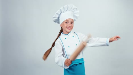 Chef-Cook-Child-7-8-Years-Dancing-With-Rollingpin-On-White-Background