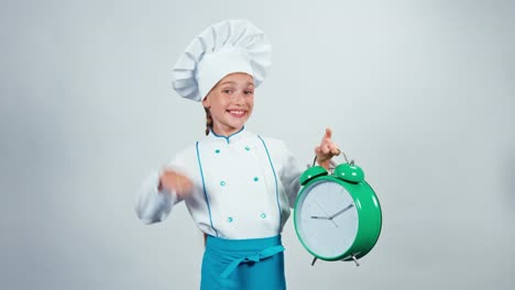 Chef-Cook-Child-7-8-Years-Holding-Alarm-Clock-And-Standing-Isolated-On-White