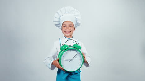 Chef-Cook-Child-7-8-Years-Holding-Alarm-Clock-Which-Ringing-Standing-Isolated