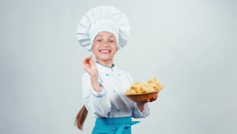 Chef-Cook-Child-7-8-Years-Holds-Plate-With-Pasta-And-Gives-You-And-Dancing