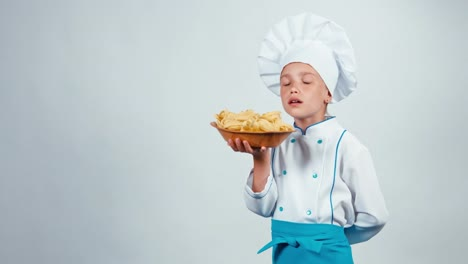 Chef-Cook-Child-7-8-Years-Holds-Plate-With-Pasta-Standing-Isolated-On-White
