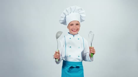 Chef-Cook-Child-7-8-Years-Holds-Soup-Ladle-And-Whisk-Standing-On-White
