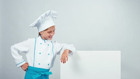 Chef-Cook-Child-7-8-Years-Leaned-On-Whiteboard-And-Smiling-At-Camera-With-Teeth