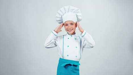 Chef-Cook-Child-7-8-Years-Preens-And-Smiling-At-Camera-Standing-Isolated